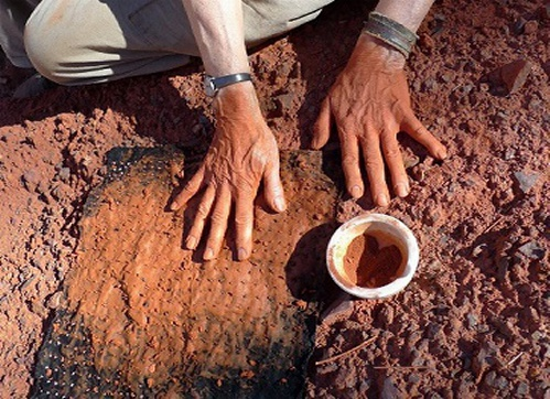 Hands in Red Clay